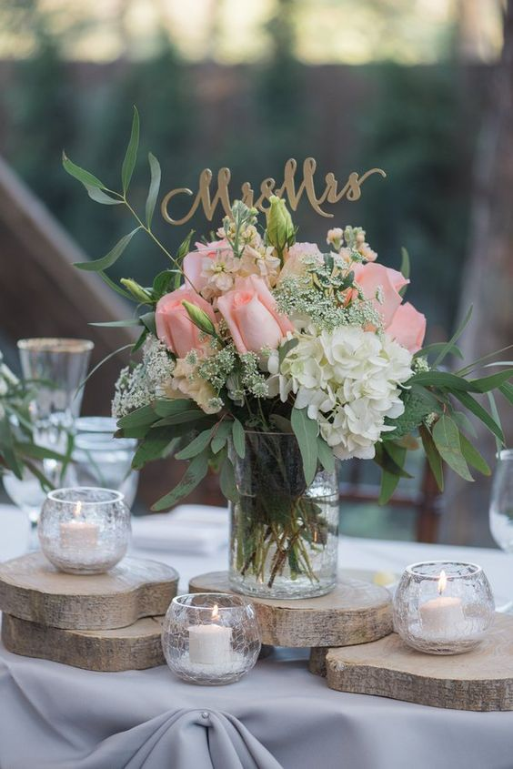 Rustic Floral Centrepiece with Log Slices and Candles